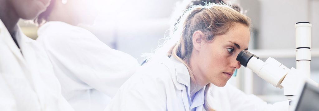 Women in a lab coat doing scientific research